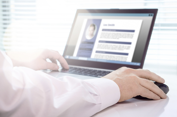 Person typing on a laptop computer.