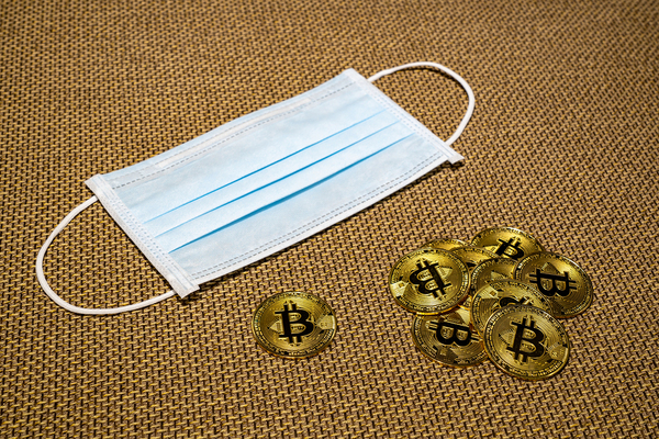 Face mask with gold coins labeled with bitcoin symbols.