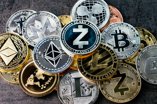 Coins labeled with cryptocurrency logos.