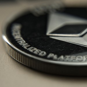 Silver coin labeled with ethereum logo.