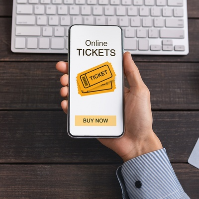 Purchasing tickets online using a phone.